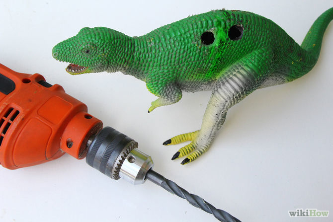 Get a power drill with large drill bit and make 4 holes on the back of the dinosaur.