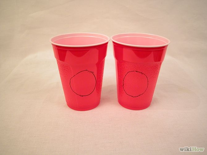 Trace circles in the cups using the paper towel roll using a pencil.